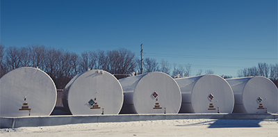 This row of fuel storage tanks could use a set of magnetostrictive probes for accurate level monitoring