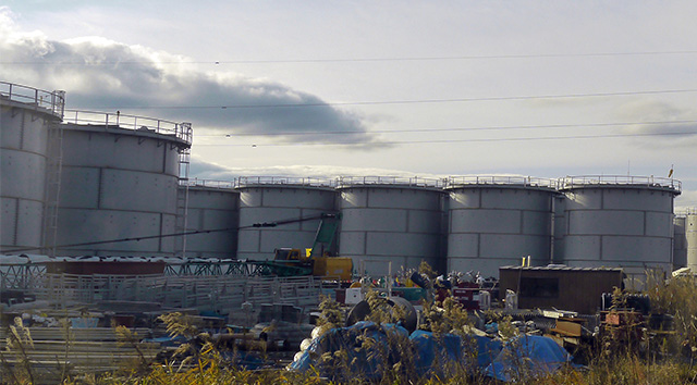 liquid storage tanks in a field