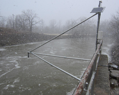 a boom for mounting an ultrasonic sensor above a river